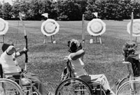 photograph of children in wheelchairs doing archery