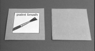 photograph of two cards.  The first card says 'paint bursh' and contains a drawing of a paint brush.  The second card is blank.